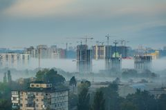 Depressing cityscape with construction of new buildings. Overpopulation concept - construction of new block bulidings, fog, toned, Kyiv, Ukraine Royalty Free Stock Photography