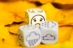 Depressing and sad weather of autumn shown on dice Stock Photo