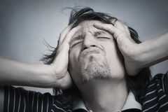 Depression. The man has clutched at the head being in a depression condition Stock Images