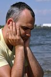 Depression. This picture represents middle age depressive man at the seashore Stock Photos