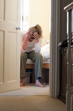 Depression. A depressed woman sat on her bed Royalty Free Stock Photo