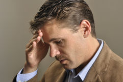 Depression. Closeup of depressed man looking down with hand on face Stock Photos