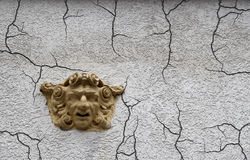 Depression. Sculpture of man's face on the wall of an old house Stock Photography