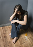 Depression. Teenage girl sitting on floor contemplating suicide stock photography
