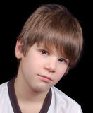 Depression. Is this boy depressed, sad, blue, unhappy, or simply ho hum?  You decide Stock Photos