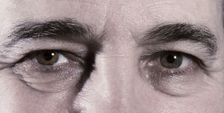 Depression. Eyes of senior aged man royalty free stock image