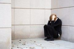 Sad girl in depression on city street Stock Photo