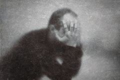 Depression. Broken man behind a dusty scratched glass royalty free stock photography