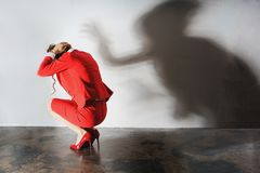 Depression or burnout at the workplace, symbolic picture. With shadow stock photos