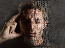 Depression composite with words like pain and anxiety composed into face of young sad man suffering stress and headache feeling
