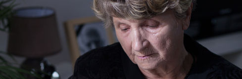 Depression after death. Old woman is depressed after husband's death Royalty Free Stock Image
