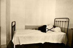 Depression. Depresed man in bed in a mental hospital royalty free stock photography