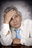 Depression. Elderly man lost in thought Stock Images