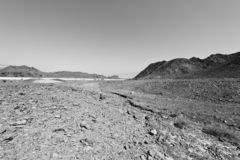 Depression and emptiness in black and white. Loneliness and emptiness of the rocky hills of the Negev Desert in Israel. Breathtaking landscape and nature of the royalty free stock images