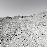 Depression and emptiness in black and white. Loneliness and emptiness of the rocky hills of the Negev Desert in Israel. Breathtaking landscape and nature of the stock image