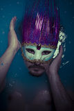 Depression, man in blue tub full of water, sadness concept Royalty Free Stock Images