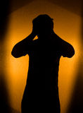 Depression and pain - silhouette of man. In the darkness Royalty Free Stock Images