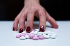 Depression and problem. Tablet overdose. Depression and problem. Hand surrounded by many pills Royalty Free Stock Photo