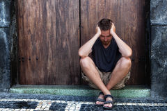 Depression - sad and poor man on the street. Depression concept - sad and poor man on the street Royalty Free Stock Image