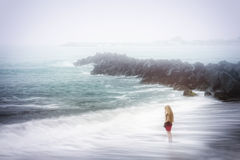 Depression and sadness concept - foggy sea. Depression and sadness concept - lonely woman and foggy sea Royalty Free Stock Photos