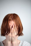 Depression, Stress or Fear. A young redhead female with wet hair covering her eyes - could be because of depression, stress or fear (of a new haircut Royalty Free Stock Images