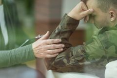 Depression after war. Young soldier suffering from depression after war Stock Image