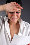 Depression woman with tears holding letter Stock Image