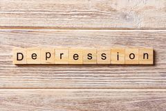 Depression word written on wood block. Depression text on table, concept.  Stock Images