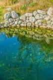 Depressione antica dell'acqua nel campo Immagine Stock