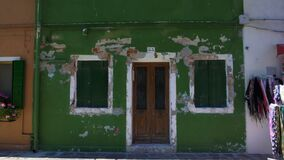 Depressive abandoned shabby building with door and windows shut, poverty problem. Stock footage stock video