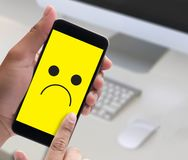Depressive emotions concept,   smiley face emoticon printed depr Royalty Free Stock Images