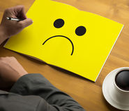 Depressive emotions concept,   smiley face emoticon printed depr Royalty Free Stock Photography