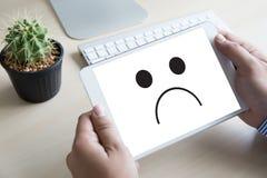 Depressive emotions concept,   smiley face emoticon printed depr Stock Images
