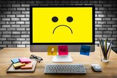 Depressive emotions concept,   smiley face emoticon printed depr Royalty Free Stock Photo