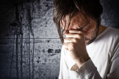 Depressive man is crying royalty free stock image