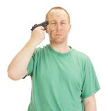 Depressive man with a gun Royalty Free Stock Photo