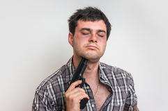 Depressive man trying to commit suicide with a gun Royalty Free Stock Photo