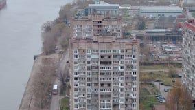 Depressive view of slum apartment houses in poor area or quater near river. Aerial shot. Depressive view of slum looking apartment houses in poor area or quater stock video footage