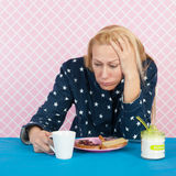 Depressive woman. With breakfast in the morning Royalty Free Stock Photo