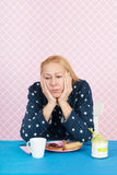 Depressive woman. With breakfast in the morning Royalty Free Stock Photos