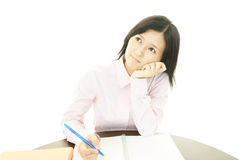 Deprimerad asiatisk affärskvinna. arkivfoto