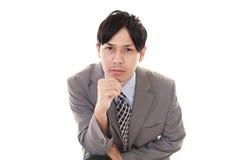 Deprimerad asiatisk affärsman arkivbilder