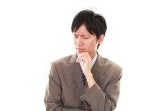 Deprimerad asiatisk affärsman royaltyfria foton