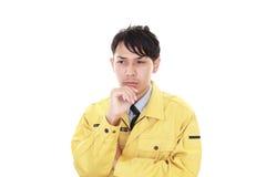 Deprimerad asiatisk arbetare arkivfoto