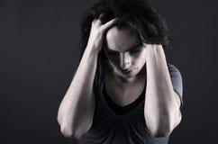 Deprimerad kvinna Arkivbild