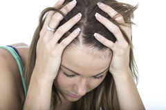 Deprimerad olycklig panikslagen ung kvinna Arkivbild
