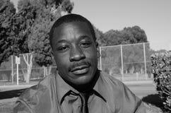 Deprimerad svart man Arkivbild