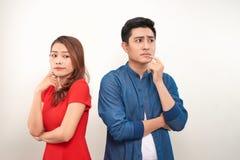Deprimerade par efter gr?lar p? vit bakgrund royaltyfria foton