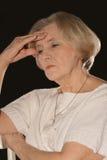 Deprimierte ältere Frau Stockfotos