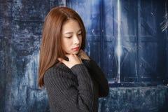 Deprimierte asiatische Frau Stockfotos